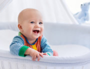 baby smiling with teeth