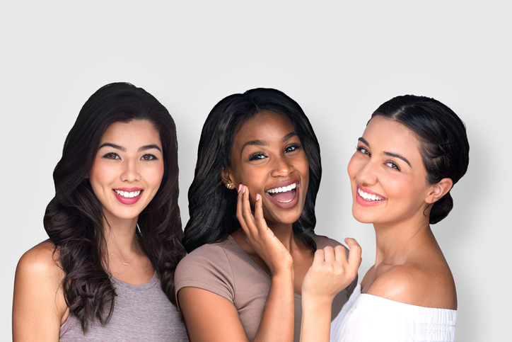 Smiling women with youthful faces