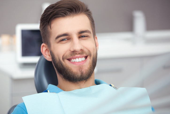 Man sitting in dentists chair