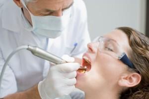 Dentist working on patients teeth